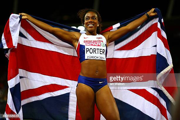 Tiffany Porter of Great Britain and Northern Ireland poses with a Union Jack as she celebrates winning gold in the women's 100m hurdles final during...