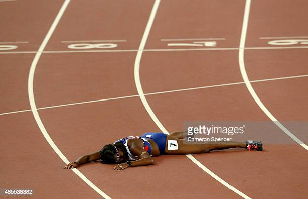 Tiffany Porter of Great Britain falls over the finish line in the Women's 100 metres hurdles final during day seven of the 15th IAAF World Athletics...