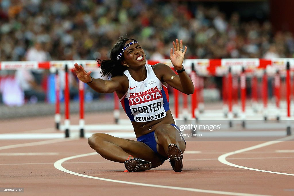 Tiffany Porter of Great Britain falls over the finish line in the Women's 100 metres hurdles final during day seven of the 15th IAAF World Athletics Championships Beijing 2015 at Beijing National Stadium on August 28, 2015 in Beijing, China.