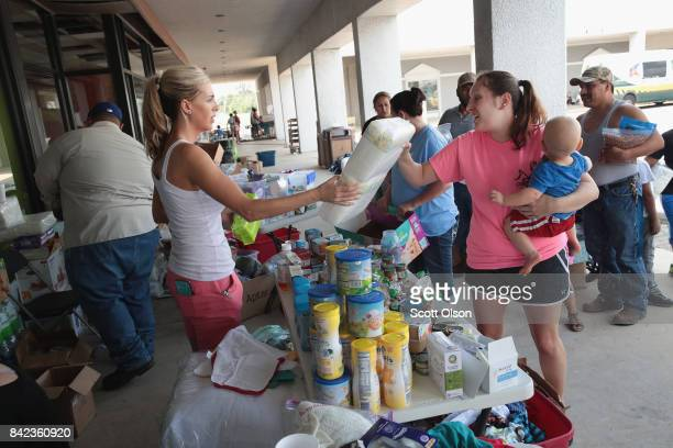 Tiffany Quillen helps to distribute relief supplies that she and a group of friends brought from North Carolina to flood victims after torrential...