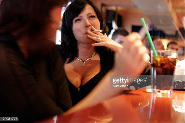 Tiffany shares a laugh over cigarettes and mixed drinks with fellow workers in the Big Sister restaurant at the brothel Big Sister on August 23 2006...