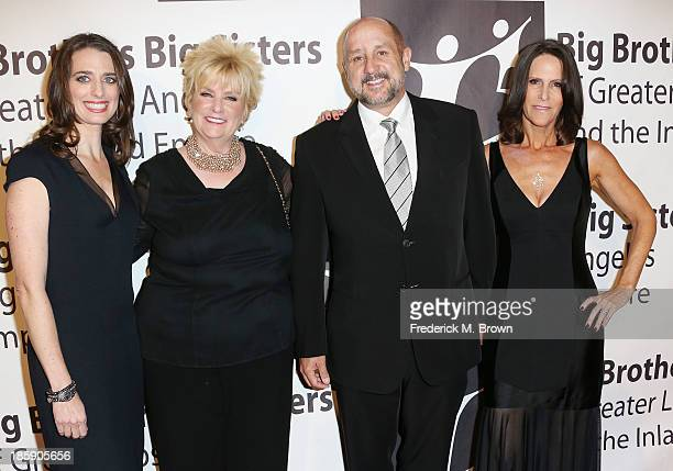 Tiffany Siart Mary Willard Roy P Disney Chairman/CEO Founder The Apogee Companies and Sheri Disney attend The Guild of Big Brothers Big Sisters of...