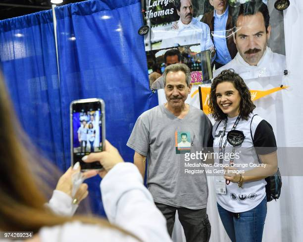 Tiffany Smith poses with actor Larry Thomas famous for being the Soup Nazi on Seinfeld at a signature booth during WonderCon in Anaheim on Friday Mar...
