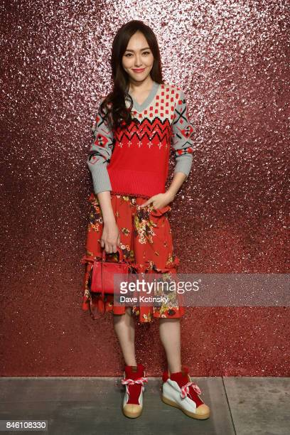 Tiffany Tang poses for a portrait during Coach Spring 2018 Fashion Show during New York Fashion Week at Basketball City Pier 36 South Street on...