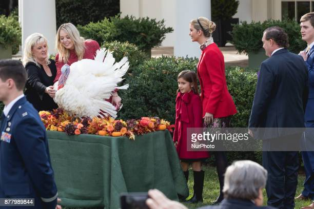 Tiffany Trump her sister Ivanka Trump right and her daughter Arabella Kushner look at Drumstick after he was pardoned by President Donald Trump at...