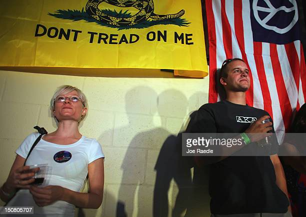 Tiffany Whipple and John Yakupkovic listen to speakers while waiting for former Republican presidential candidate Rep Ron Paul to arrive to speak to...