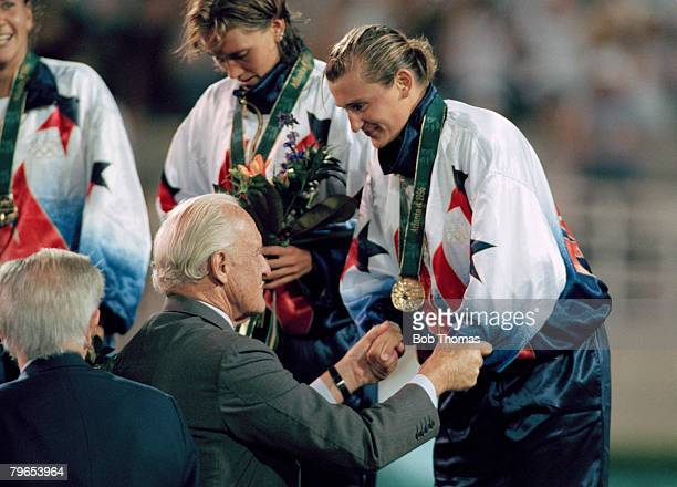 Tiffeny Milbrett of the United States Women's football squad receives her gold medal from FIFA President Joao Havelange after her team beat China 2 -...