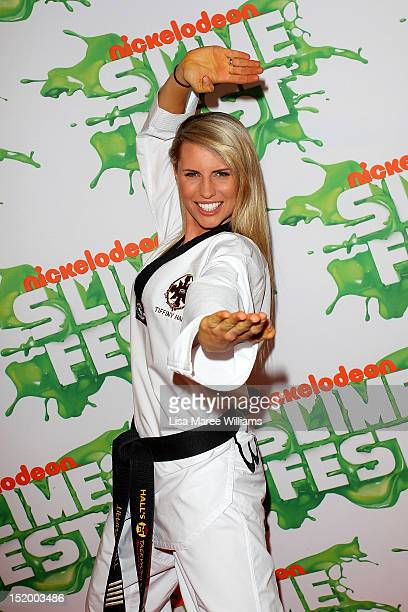Tiffiny Hall poses on the media wall ahead of the Nickelodeon Slimefest 2012 evening show at Hordern Pavilion on September 15 2012 in Sydney Australia