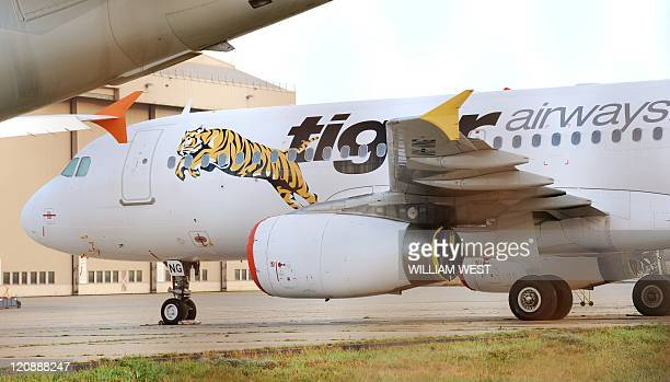 Tiger Airways plane sits on the tarmac as the budget carrier resumed flights in Australia, six weeks after regulators slapped a suspension on the...