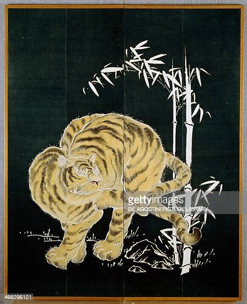 Tiger and bamboo motif on two door cotton screen rice starch and indigo dip with pigments Japanese civilisation MeijiTaisho period 18681926