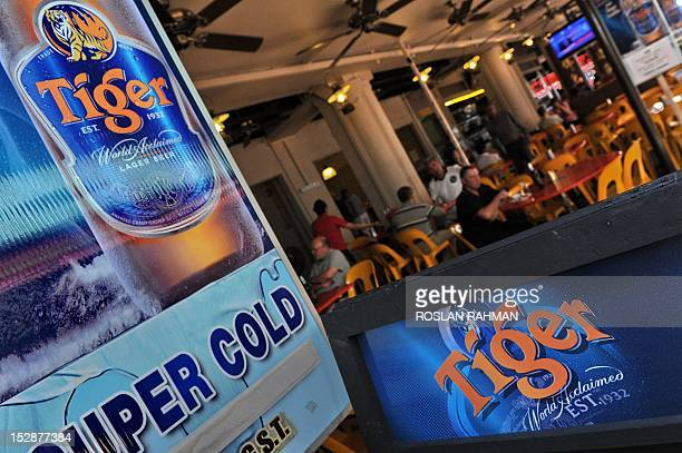 Tiger beer advertisement posted outside a coffee shop in Singapore on September 28 2012 Shareholders in the parent company of the Singaporebased...