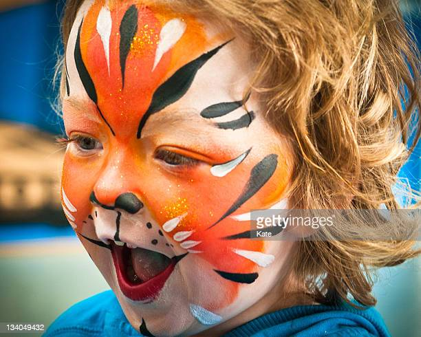 tiger girl - face paint stock pictures, royalty-free photos & images