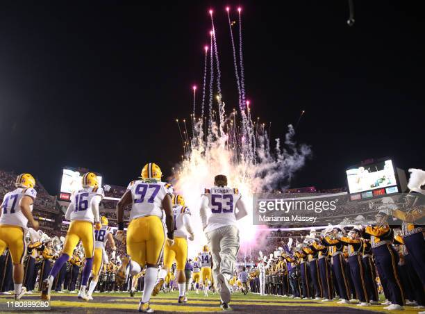 Tiger players run onto the field prior to the start of the game against the Florida Gators at Tiger Stadium on October 12, 2019 in Baton Rouge,...