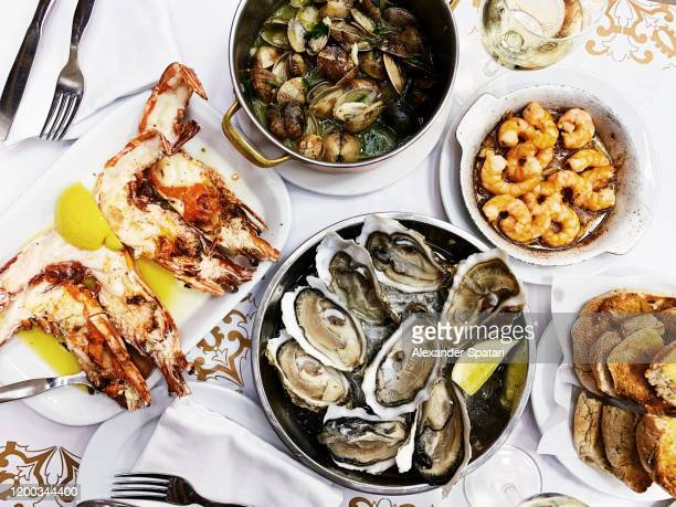 tiger prawns, oysters, clams and shrimps served in a seafood restaurant - portuguese culture stock pictures, royalty-free photos & images