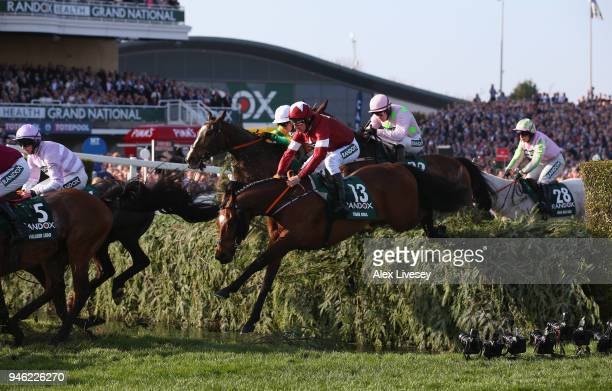 Tiger Roll ridden by Davy Russell jump the Water Jump on their way to victory in the Randox Health Grand National Handicap Steeple Chase at Aintree...