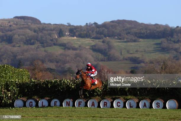 Tiger Roll ridden by Keith Donoghue is seen jumping a fence during the Glenfarclas Chase race on Day Two of the Cheltenham Festival 2021 at...