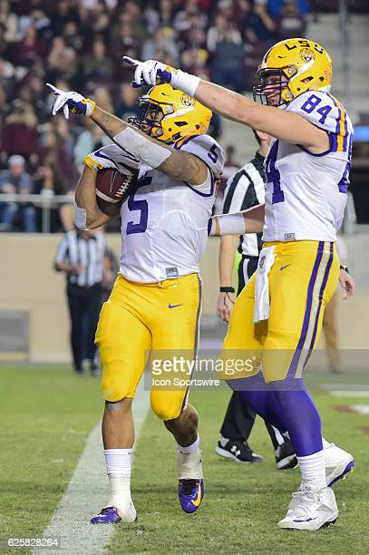 Tiger running back Derrius Guice points to the crowd with LSU Tiger tight end Foster Moreau as they celebrate Guice's second half rushing touchdown...