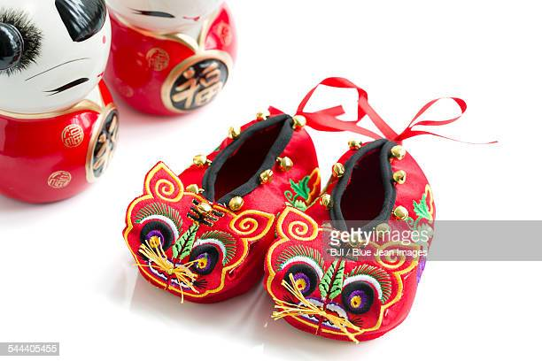 Tiger shoes and Chinese dolls