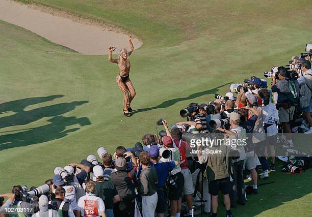 A Tiger striped body painted streaker poses for the photographers during the British Open on 20 July 1997 at the Royal Troon Golf Club in Troon...
