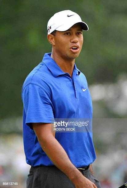 Tiger Wood of the US walks on the third green in the third round at the 91st PGA Championship at the Hazeltine National Golf Club in Chaska,...