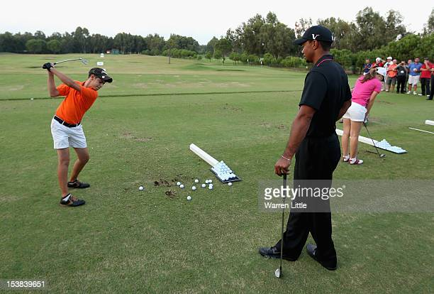 Tiger Wood of the USA teaches during a junior golf clinic after day one of the Turkish Airlines World Golf Final at Antalya GC on October 9, 2012 in...