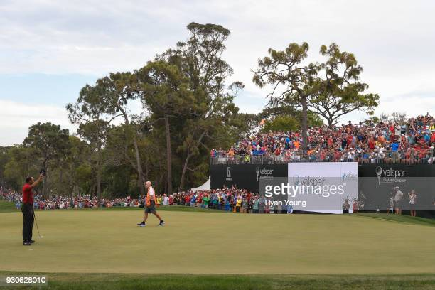Tiger Woods acknowledges the crowd on the 18th hole during the final round of the Valspar Championship at Innisbrook Resort on March 11 2018 in Palm...