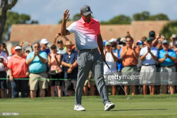 Tiger Woods acknowledges the crowd on the fourth green during the second round of the Honda Classic at PGA National Resort and Spa on February 23...