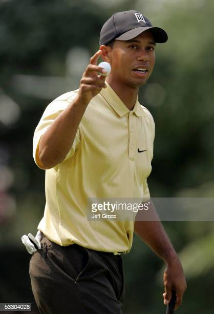 Tiger Woods acknowledges the gallery after making a birdie putt on the 15th hole during the second round of the Buick Open on July 29 2005 at the...