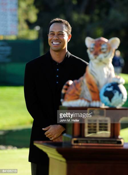 Tiger Woods addresses the gallery after presenting Vijay Singh with the Tiger Trophy after he won the 2008 Chevron World Challenge with a 5-under par...
