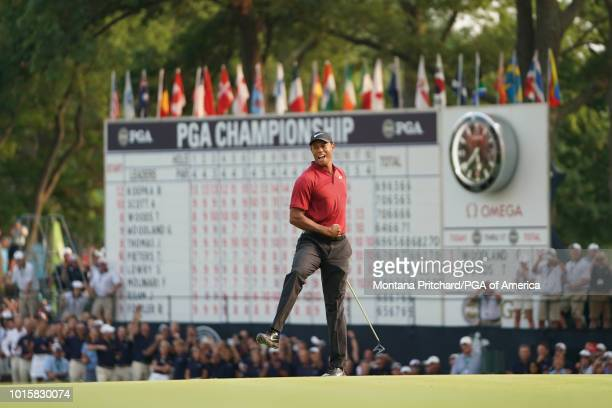 Tiger Woods after making his putt on the 18th hole during the final round of the 100th PGA Championship held at Bellerive Golf Club on August 12 2018...