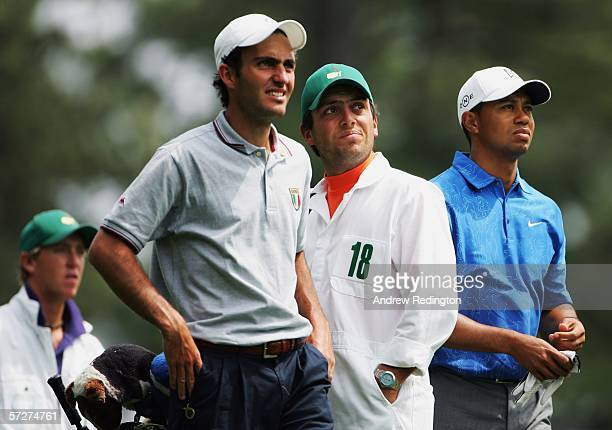 Tiger Woods and amateur Edoardo Molinari of Italy with brother and caddie Francesco Molinari on the fourth tee during the second round of The Masters...