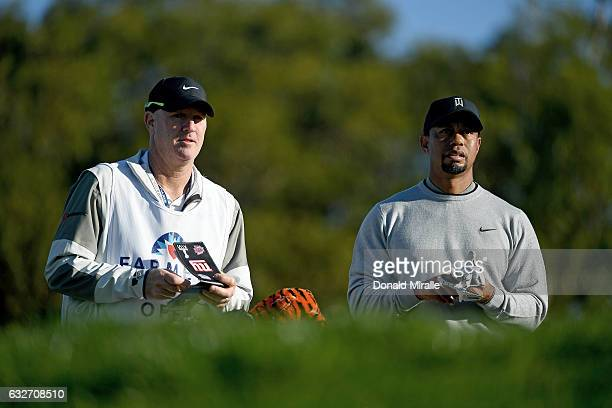 Tiger Woods and caddie Joe LaCava look on during the Zurich ProAm Farmers Insurance Open Preview Day 3 at Torrey Pines Golf Course on January 25 2017...