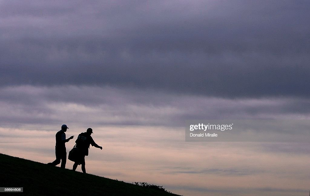 Tiger Woods and caddie Steve Williams walk on a fairway during the 3rd Round of the Buick Invitational on January 28, 2006 at Torrey Pines Golf Course in La Jolla, California.