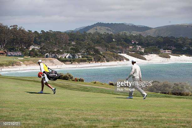 Tiger Woods and caddie Steve Williams walk on the sixth hole fairway during third round of the 110th US Open at Pebble Beach Golf Links on June 19...
