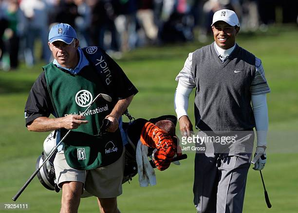 Tiger Woods and caddie Steve Williams walk up to the ninth green during the second round of the Buick Invitational at the Torrey Pines Golf Course on...