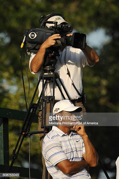 Tiger Woods and CBS videotaping on hole 17 tee during the second round of play at the 91st PGA Championship at Hazeltine National Golf Club in Chaska...
