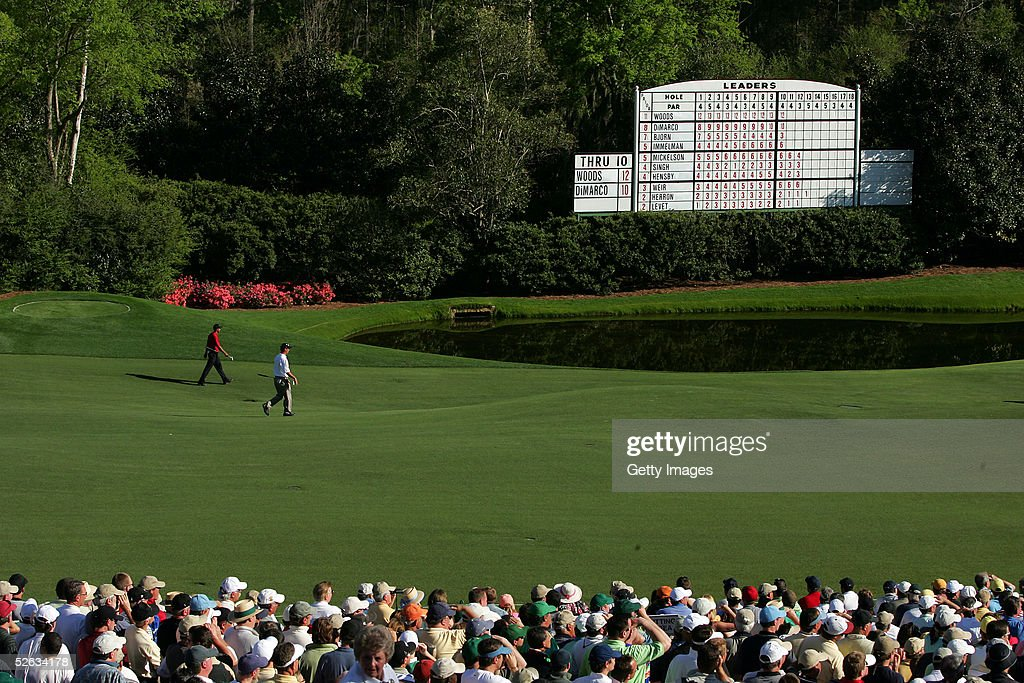 Tiger Woods and Chris DiMarco walk up the fairway on the 11th hole during the final round of the 2005 Masters on April 10, 2005 at Augusta National Golf Course in Augusta, Georgia.