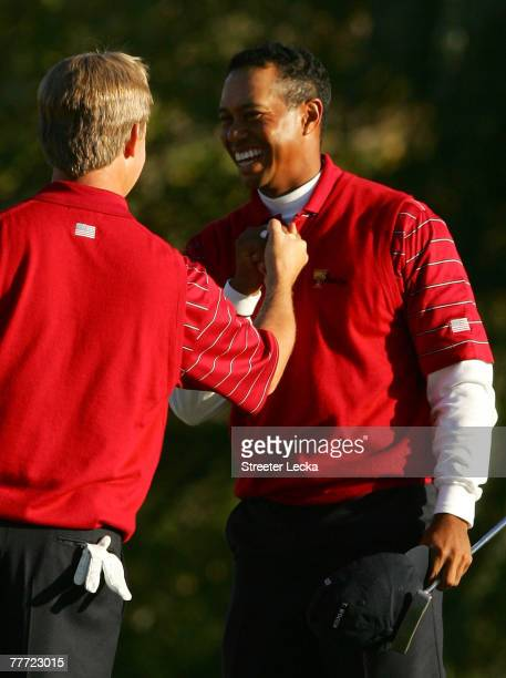 Tiger Woods and David Toms of the U.S. Team celebrate after winning their match on the 15th hole during the third day Foursome matches at The...