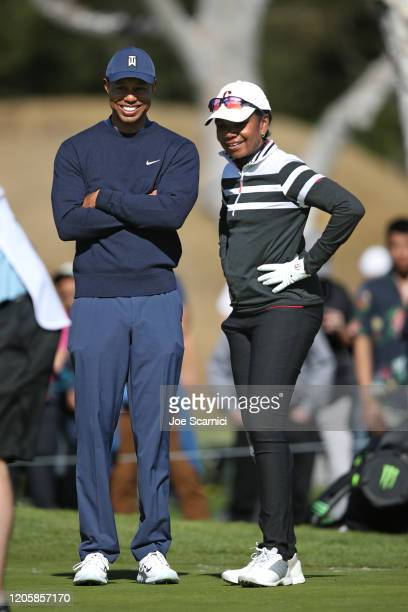 Tiger Woods and former US Secretary of State Condoleezza Rice chat on a green during the ProAm at the Genesis Invitational Preview Day 3 on February...