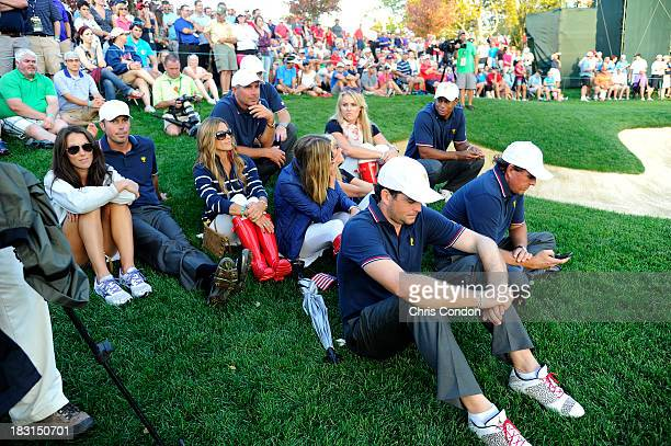 Tiger Woods and girlfriend Lindsey Vonn follow the play with members of the US Team during the Day One FourBall Matches of The Presidents Cup at the...
