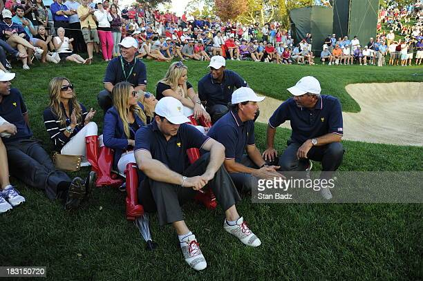 Tiger Woods and girlfriend Lindsey Vonn with members of the US Team follow the play during the Day One FourBall Matches of The Presidents Cup at the...