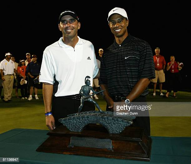 Tiger Woods and Hank Kuehne stand with the trophy after winning the Lincoln Financial Battle of the Bridges on August 2, 2004 at the Bridges in...