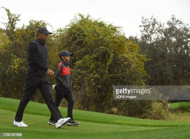 Tiger Woods and his 11-year-old son Charlie play the 10th hole during the pro-am round at the PNC Championship golf tournament at the Ritz-Carlton...