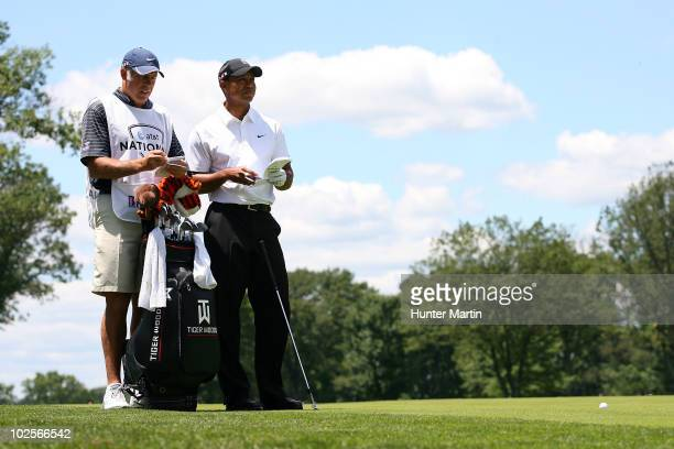 Tiger Woods and his caddie Steve Williams look down the fairway on the third hole during the first round of the ATT National at Aronimink Golf Club...