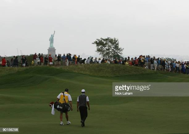 Tiger Woods and his caddie Steve Williams walk up the 17th fairway during roudn two of The Barclays on August 28 2009 at Liberty National in Jersey...