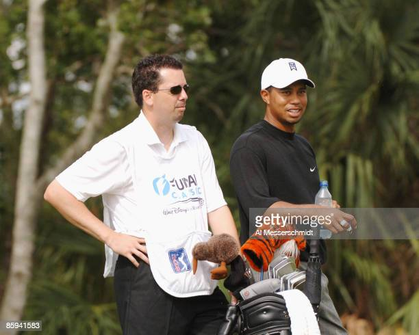 Tiger Woods and his caddy Bryon Bell wait for play on the ninth tee during the second round of the 2005 Funai Classic at World Disney World Resort in...