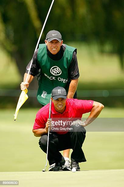 Tiger Woods and his caddy Steve Williams line up a putt on the 4th hole during the final round of the Buick Open at Warwick Hills Golf and Country...