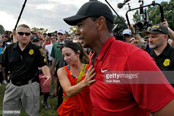 Tiger Woods and his girlfriend Erica Herman celebrate after the final round of the TOUR Championship at East Lake Golf Club on September 23 in...