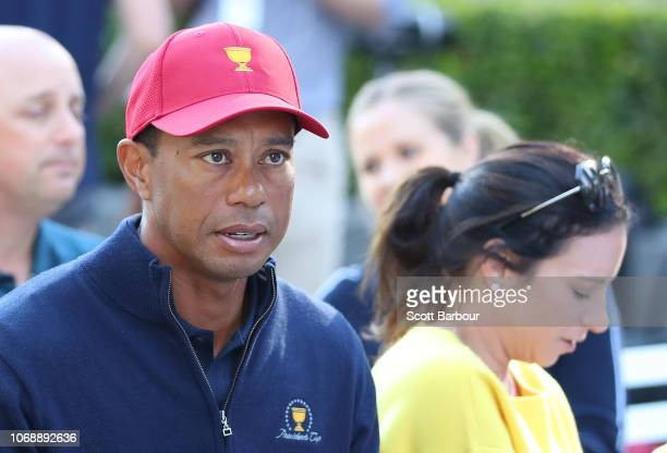 Tiger Woods and his girlfriend Erica Herman look on during a Presidents Cup media opportunity at the Yarra Promenade on December 5 2018 in Melbourne...