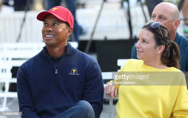 Tiger Woods and his girlfriend Erica Herman look on during a Presidents Cup media opportunity at the Yarra Promenade on December 5, 2018 in...